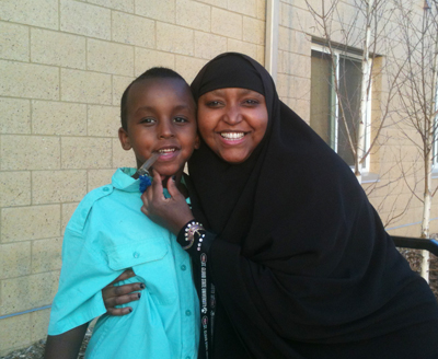 Residents of Sienna Green, Hodan Abdulkadir & Her Son Abdirahmand, pose for a picture.